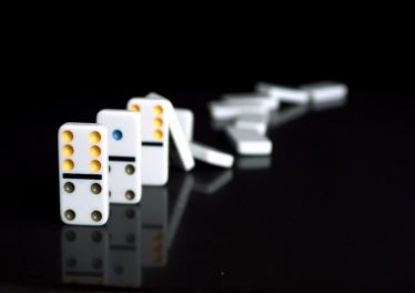 122047631-domino-effect-dominoes-collapse-board-game